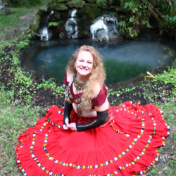 MELISSA JACKSON The Belly Dancing Yoga & FireFlex Yoga Teacher at Yoga Fun Day Will Be Teach at Space Coast Yoga Festival